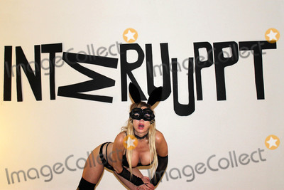 Photo - Nadeea Volianovathe Russian Pop Stars 2nd Art Installation Interrupt a comment on Russian hacking which is a follow up to her Putin  Trump Installation last month Art Threat Gallery Las Vegas NV 01-16-17