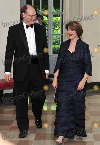 Amy Klobuchar Photo - United States Senator Amy Klobuchar (Democrat of Minnesota) and her husband John Bessler arrive for a State Dinner in honor of Chancellor Angela Merkel of Germany at the White House in Washington DC  on Tuesday June 7 2011  Sen Klobuchar proudly boasted she spent 17000 blue dress and jacket she wore and another 2900 on her shoes Photo by Ron SachsCNP-PHOTOlinknet