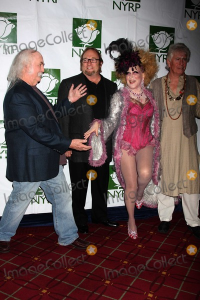 Bette Midler Photo - Crosby Stills Nash Midler8435JPGNYC  103009Bette Midler (dressed as a Showghoul) with David Crosby Stephen Stills and Graham Nash at Bette Midlers annual HULAWEEN Gala supporting New York Restoration Project at the Waldorf AstoriaDigital Photo by Adam Nemser-PHOTOlinknet