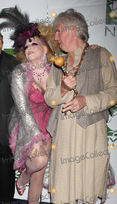Bette Midler Photo - Crosby Stills Nash Midler8414JPGNYC  103009Bette Midler (dressed as a Showghoul) with Graham Nash at Bette Midlers annual HULAWEEN Gala supporting New York Restoration Project at the Waldorf AstoriaDigital Photo by Adam Nemser-PHOTOlinknet