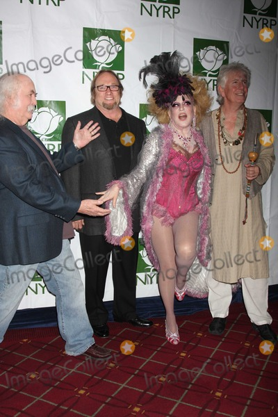 Bette Midler Photo - Crosby Stills Nash Midler8434JPGNYC  103009Bette Midler (dressed as a Showghoul) with David Crosby Stephen Stills and Graham Nash at Bette Midlers annual HULAWEEN Gala supporting New York Restoration Project at the Waldorf AstoriaDigital Photo by Adam Nemser-PHOTOlinknet