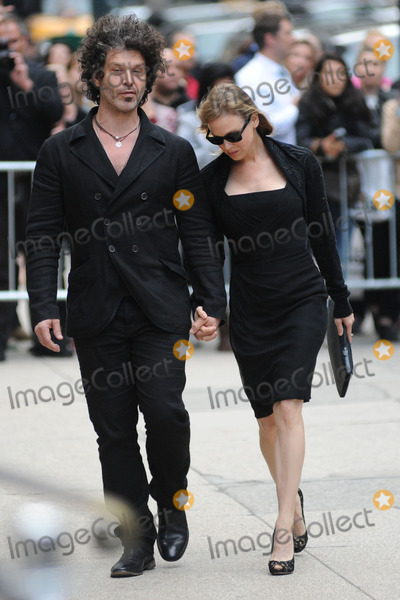 Renee Zellweger Photo - May 2 2014 New York CityDoyle Bramhall II and Renee Zellweger attending a memorial service for L Wren Scott at St Bartholomews Church in New York City on May 2 2014
