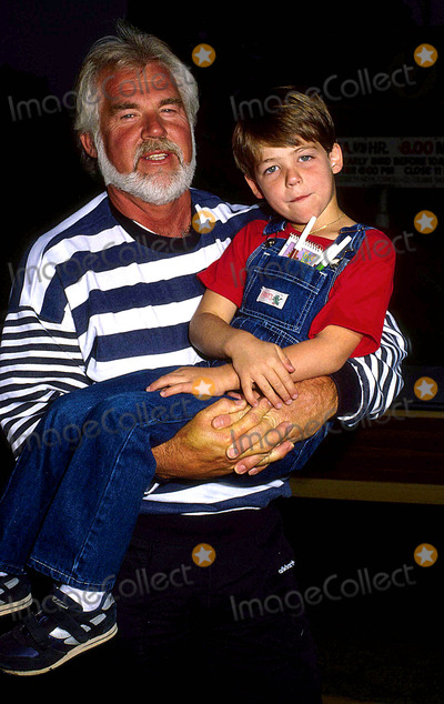 Kenny Rogers Photo - Kenny Rogers with His Son Christopher Cody 1987 14492 Photo by Phil Roach-ipol-Globe Photos Inc