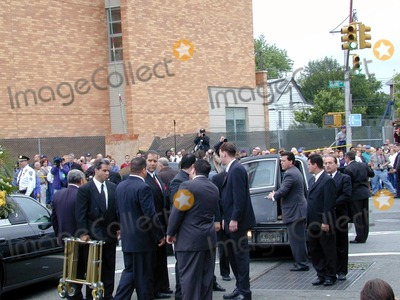 John Gotti Photo - Queens NY John Gotti Funeral at Papavero Funeral Home Friends and Family Arrive Under Cover of Umbrellas Also Flowers Put Into Cars Casket Taken Out to Hearse Photo Bruce Cotler