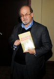 Salman Rushdie Photo - 26 October 2012 - Hamilton Ontario Canada  British author Salman Rushdie poses in the green room with a copy of his book Joseph Anton A Memoir during an apperance at the Lincoln Alexander Centre Photo Credit Brent PerniacAdMedia