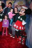 Alyson Hannigan Photo - Alyson Hannigan and Alexis Denisof with childrenat Disney On Ice Presents Lets Celebrate Staples Center Los Angeles CA 12-11-14