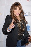 Tisha Campbell Photo - Tisha Campbell-Martinat the Blue Tie Blue Jean Ball presented by Austism Speaks Beverly Hilton Beverly Hills CA 11-29-12