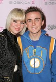 Frankie Muniz Photo - Frankie Muniz and friendat the launch party for the Custom-Designed T-Mobile Sidekick II Series T-Mobile Sidekick II City Hollywood CA 10-18-05