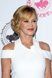 Melanie Griffith Photo - LOS ANGELES - OCT 8  Melanie Griffith note tattoo of Antonio almost gone at the 2016 Carousel Of Hope Ball at the Beverly Hilton Hotel on October 8 2016 in Beverly Hills CA