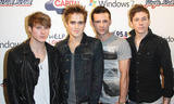 Harry Judd Photo - McFly band members Dougie Poynter Tom Fletcher Harry Judd and Danny Jones pose on the red carpet during the Capital FM Jingle Bell Ball 2010  The annual star-studded fundraising event benefits charities including Gimme Shelter London UK 120410
