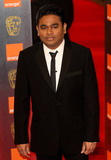 AR Rahman Photo - A R Rahman poses for photographers on the red carpet at the 2011 Orange British Academy Film Awards held at The Royal Opera House in Covent Garden London UK 021311