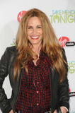 Tawny Kitaen Photo - Personality Tawny Kitaen arriving at the premiere of Take Me Home Tonight held at Regal Cinemas LA Live Stadium 14 on March 2 2011 in Los Angeles CA