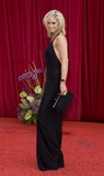 Kim Tiddy Photo - Kim Tiddy  arrives for the 2011 Soap Awards held at Granada Studios in Manchester 14052011 Picture by Simon BurchellFeatureflash