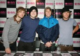 Harry Judd Photo - Milton KeynesUK Pop music band  McFly sign copies of their new double A sided single Transylvania Babys Coming Back at HMV Milton Keynes  9th May 2007  L-R   Harry Judd Tom Fletcher  Danny Jones and Dougie Poynter   Keith MayhewLandmark Media