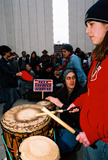JFK Photo - Anti-war Demonstration Jfk Memorial Dallas Tx 02-15-03 17 Year Old Dallas Native Christie Kyle Leads a Drum Circle Photojeff Newman  Globe Photos Inc 2003