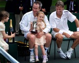 Bjorn Borg Photo - ALPHA M041288 02072000 LONDONJOHN McENROE   DAUGHTER FOUR YEAR OLD ANNA McENROE HOLDS HER FATHERS TROPHY AS HIS OTHER DAUGHTER EMILY (LEFT) BRINGS SOME CHAMPAGNE FOR WINNING A CHARTY MATCH AGAINST BJORN BORG (R)-NSPCC CHILDRENS CHARITY TENNIS MATCHAT BUCKINGHAM PALACE  LONDON