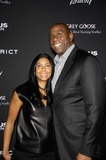 Magic Johnson Photo - Cookie Johnson and Earvin Magic Johnson During the Premiere of the New Movie From Filmdistrict Olympus Has Fallen Held at the Arclight Cinemas on March 18 2013 in Los Angeles Photo Michael Germana - Globe Photos