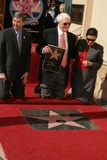 Peter Graves Photo - Peter Graves Honored with Star on the Hollywood Walk of Fame 6667 Hollywood Blvd Hollywood CA 103009 Leron Gubler with Peter Graves and Wife Joan Endress Photo Clinton H Wallace-photomundo-Globe Photos Inc