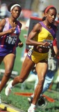Jackie Joyner-Kersee Photo - Jackie Joyner Kersee 1991 National Championships Photo by Chuck Muhlstock-Globe Photos