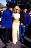 Mindy McCready Photo - 32nd Academy of Country Music Awards Mindy Mccready with Kenny Chesney and David Kirsh Photo Lisa Rose  Globe Photos Inc
