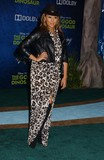 Tamera Mowry Photo - Tamera Mowry attends the Premiere of the Good Dinosaurat the Chinese Theater in Hollywoodca on November172015 Photo by Phil Roach-ipol-Globe Photos