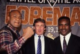George Foreman Photo - Evander Holyfield with George Foreman Press Conference at Grand Hyatt in New York 1990 L0812 Photo by John Barrett-Globe Photos Inc with Donald Trump