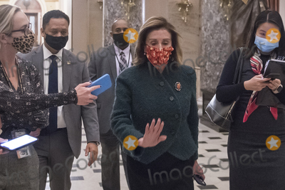 Photos From United States House of Representatives Nancy Pelosi (Democrat of California) walks from the House chamber to her office at the U.S. Capitol during a vote .