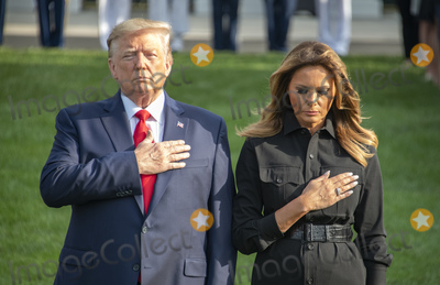 Photos From Donald J. Trump and Melania Trump Observe a Moment of Silence