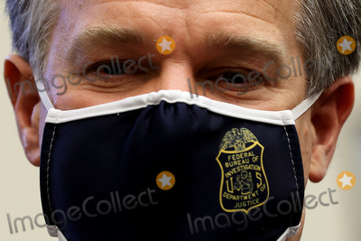 Photo - Wearing a face mask to reduce the risk posed by the coronavirus Federal Bureau of Investigation Director Christopher Wray leaves after testifying before the House Homeland Security Committee about worldwide threats to the homeland in the Rayburn House Office Building on Capitol Hill September 17 2020 in Washington DC Committee Chairman Bennie Thompson (D-MS) said he would issue a subpoena for acting Homeland Security Secretary Chad Wolf after he did not show for the hearing An August Government Accountability Office report found that Wolfs appointment by the Trump Administration which has regularly skirted the Senate confirmation process was invalid and a violation of the Federal Vacancies Reform Act Credit Chip Somodevilla  Pool via CNPAdMedia