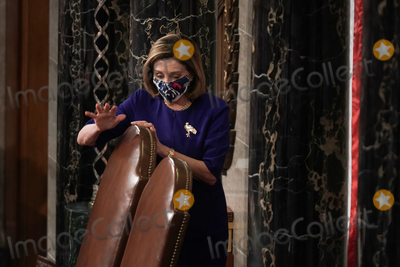 Photo - Speaker of the United States House of Representatives Nancy Pelosi (Democrat of California) calls the House in order prior to a joint session of Congress to count the Electoral College votes from the 2020 presidential election on Wednesday January 6 2021Credit Greg Nash  Pool via CNPAdMedia