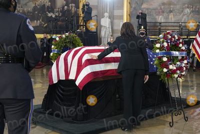 Photo - United States Vice President Kamala Harris pays respects to slain US Capitol Police officer William Billy Evans as he lies in honor at the Capitol in Washington Tuesday April 13 2021 Credit Jacquelyn Martin  Pool via CNPAdMedia