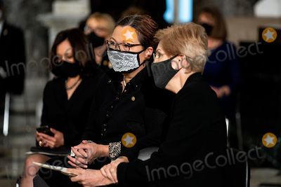 Photo - United States Senator Tammy Duckworth (Democrat of Illinois) and US Senator Elizabeth Warren (Democrat of Massachusetts) before a ceremony where Justice Ruth Bader Ginsburg lies in state in Statuary Hall of the Capitol in Washington DC on September 25 2020 Credit Erin Schaff  Pool via CNPAdMedia