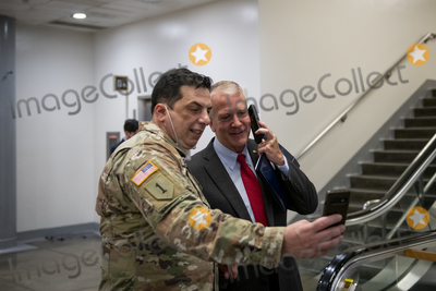 alaska Photo - United States Senator Dan Sullivan (Republican of Alaska) right poses with Vincent Scalise left of Veterans Outreach Center as he passes through the Senate subway for a vote at the US Capitol in Washington DC Tuesday March 2 2021 Credit Rod Lamkey  CNPAdMedia