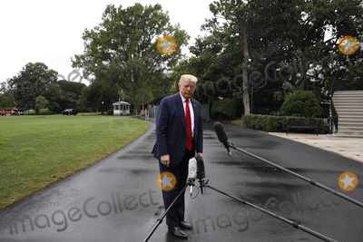 Photos From Donald Trump Departs to Tampa