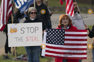 Photos From Protesters demonstrate as United States President Donald J. Trump visits Trump National Golf Club