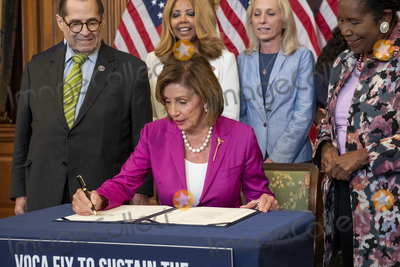 Photo - Speaker of the United States House of Representatives Nancy Pelosi (Democrat of California) center is joined by United States Representative Jerrold Nadler (Democrat of New York) Chairman US House Judiciary Committee left and United States Representative Sheila Jackson-Lee (Democrat of Texas) right for a bill enrollment photo op for HR 1652 - VOCA Fix to Sustain the Crime Victims Fund Act of 2021 at the US Capitol in Washington DC Wednesday July 21 2021 Credit Rod Lamkey  CNPAdMedia