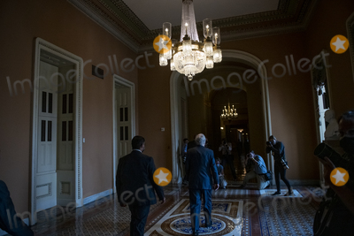 Photo - United States Senate Minority Leader Mitch McConnell (Republican of Kentucky) walks to his office following a press conference following the Senate Republicans policy luncheon at the US Capitol in Washington DC Tuesday September 14 2021 Credit Rod Lamkey  CNPAdMedia