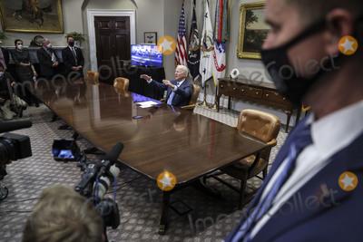 Photos From President Biden participates in a virtual call to congratulate the NASA JPL Perseverance team on the successful Mars landing