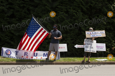 Photo - Supporters of and demonstrators against United States President Donald J Trump gather in front of Trump National Golf Club in Sterling Virginia on Sunday August 2 2020 as he prepares to go back to the White House in Washington DC US  Credit Stefani Reynolds  CNPAdMedia