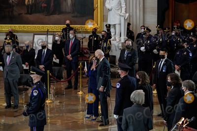 Photo - United States President Joseph R Biden Jr and Speaker of the US House of Representatives Nancy Pelosi (Democrat of California) attend a lying in honor ceremony for US Capitol Police officer William Billy Evans in the Rotunda of the US Capitol in Washington DC on Tuesday April 13 2021 Credit Amr Alfiky  Pool via CNPAdMedia