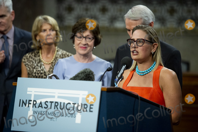 Photo - United States Senator Kyrsten Sinema (Democrat of Arizona) makes remarks after the vote on the motion to invoke cloture to proceed to the consideration of HR 3684 the INVEST in America Act on Capitol Hill in Washington DC on Wednesday July 28 2021 The vote to begin discussion of the bipartisan infrastructure bill agreed to by the White House was 67 to 32 If passed the bill would invest close to 1 trillion in roads bridges ports and other infrastructure without a major tax increaseCredit Rod Lamkey  CNPAdMedia