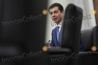 Photo - Pete Buttigieg US secretary of transportation nominee for US President Joe Biden speaks during a Senate Commerce Science and Transportation Committee confirmation hearing in Washington DC US on Thursday Jan 21 2021 Buttigieg is pledging to carry out the administrations ambitious agenda to rebuild the nations infrastructure calling it a generational opportunity to create new jobs fight economic inequality and stem climate changeCredit Stefani Reynolds  Pool via CNPAdMedia
