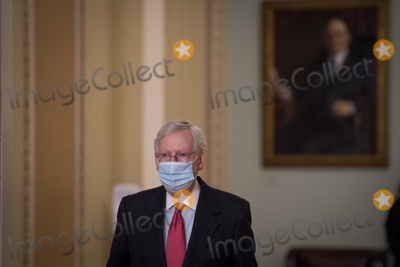Photo - United States Senate Majority Leader Mitch McConnell (Republican of Kentucky) leaves the Senate chamber at the US Capitol during a vote
