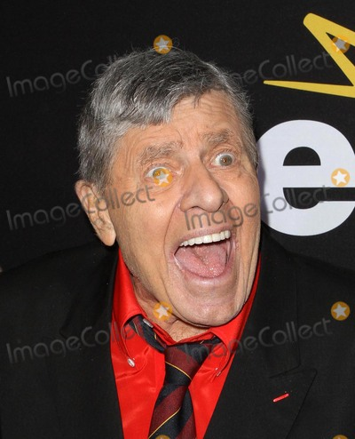Jerry Lewis Photos - 20 August 2017 - Jerry Lewis the brash slapstick comic who became a pop culture sensation in his partnership with Dean Martin and then transformed himself into an auteur filmmaker of such comedic classics as The Nutty Professor and The Bellboy has died in Las Vegas at the age of 91 For most of his career Lewis was a complicated and sometimes polarizing figure An undeniable comedic genius he pursued a singular vision and commanded a rare amount of creative control over his work with Paramount Pictures and other studios He legacy also includes more than 25 billion raised for the Muscular Dystrophy Association through the annual Labor Day telethon that he made an end-of-summer ritual for decades until he was relieved of the hosting job in 2011 In addition to his most famous films Lewis also appeared in a number of notable works such as Martin Scorseses The King of Comedy but was largely offscreen from the late 60s on and was more active with his telethon and philanthropic efforts As late as 2016 Lewis continued to perform in Las Vegas where he first debuted his comedy routine back in 1949 File Photo 7 December 2011 - Los Angeles California - Jerry Lewis Premiere Of Encores Method To The Madness Of Jerry Lewis Held At The Paramount Studios lot Photo Credit Kevan BrooksAdMedia