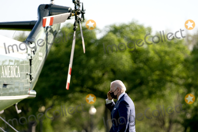 Marine One Photo - US President Joe Biden salutes before boarding Marine One on the Ellipse of the White House in Washington DC US on Friday April 16 2021 Biden will travel to Wilmington Delaware for the weekend Credit Stefani Reynolds  Pool via CNPAdMedia