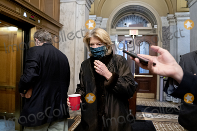 alaska Photo - Senator Lisa Murkowski a Republican from Alaska wears a protective mask while arriving to the US Capitol in Washington DC US on Saturday Feb 13 2021 The Senate voted to consider a request for witnesses at Donald Trumps impeachment trial injecting a chaotic new element that could end up prolonging proceedings that appeared to be on track to wrap up today Credit Stefani Reynolds - Pool via CNPAdMedia