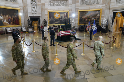Photo - Members of the National Guard walk past the casket of slain US Capitol Police officer William Billy Evans as he lies in honor at the Capitol in Washington Tuesday April 13 2021Credit Susan Walsh  Pool via CNPAdMedia