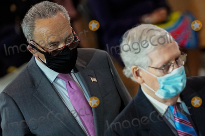 Photo - United States Senate Minority Leader Mitch McConnell (Republican of Kentucky) and US Senate Majority Leader Chuck Schumer (Democrat of New York) attend a lying in honor ceremony for US Capitol Police officer William Evans in the Rotunda of the US Capitol in Washington DC on Tuesday April 13 2021 Credit Amr Alfiky  Pool via CNPAdMedia