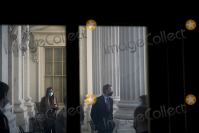 Photo - United States Senator John Thune (Republican of South Dakota) poses for photos with staff members on the Senator Bob Dole Balcony at the US Capitol