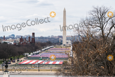 Photo - A giant American flag is unfurled on the National Mall during a dress rehearsal ahead of the 59th Inaugural Ceremonies on the West Front of the US Capitol in Washington DC US Monday Jan 18 2021 Biden ascends to the presidency on Wednesday with an inaugural speech outlining how hell tackle the health and economic crises he inherits while attempting to knit the country back together just two weeks after the outgoing presidents loyalists waged a deadly riot to block the change of power Credit Jeenah Moon  Pool via CNPAdMedia